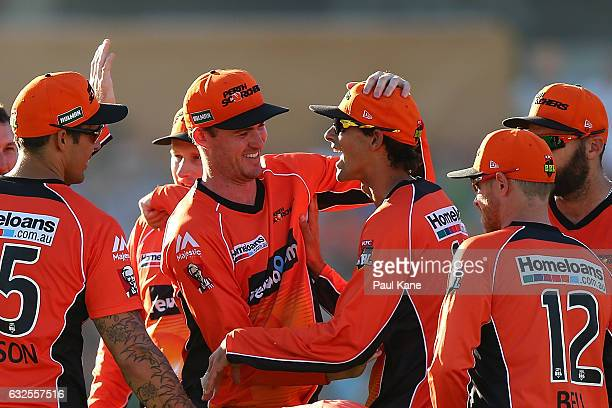 Ashton Turner of the Scorchers congratulates Ashton Agar after taking a catch to dismiss Seb Gotch of the Starsduring the Big Bash League match...