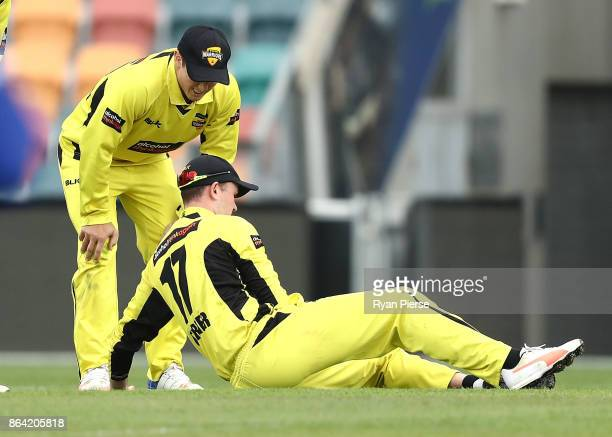Ashton Turner of the Warriors lands on his arm while fielding during the JLT One Day Cup Final match between Western Australia and South Australia at...