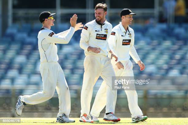 Ashton Turner of Western Australia celebrates the wicket of Daniel Hughes of New South Wales with Cameron Bancroft and Adam Voges during the...