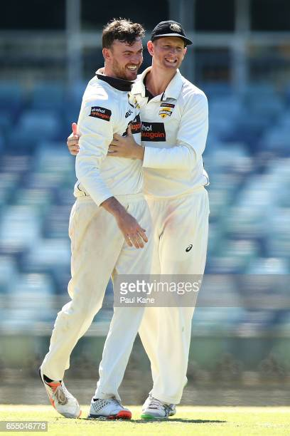 Ashton Turner of Western Australia celebrates the wicket of Daniel Hughes of New South Wales with Adam Voges during the Sheffield Shield match...