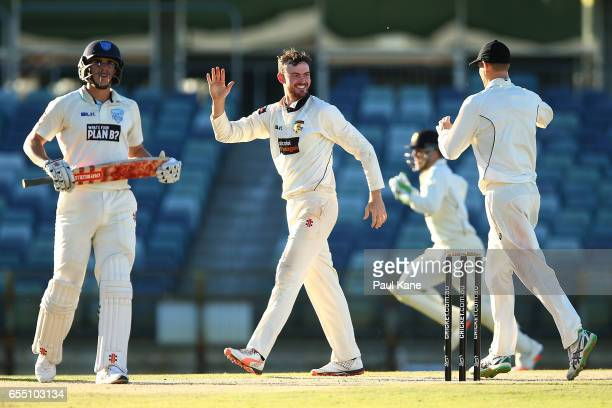 Ashton Turner of Western Australia celebrates the wicket of Sean Abbott of New South Wales during the Sheffield Shield match between Western...