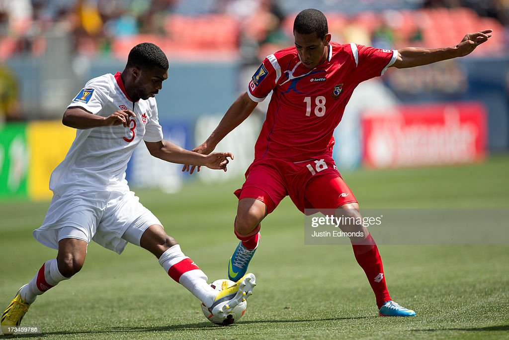 Ashtone Morgan #3 of Canada battles for the ball with Jairo Jimenez #18 of Panama during the second half of a CONCACAF Gold Cup match at Sports Authority Field at Mile High on July 14, 2013 in Denver, Colorado. Canada and Panama played to a 0-0 draw.