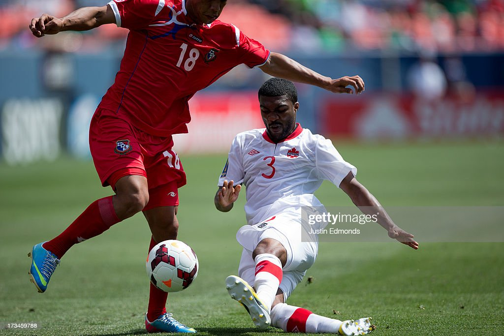 Ashtone Morgan #3 of Canada tackles the ball away from Jairo Jimenez #18 of Panama during the second half of a CONCACAF Gold Cup match at Sports Authority Field at Mile High on July 14, 2013 in Denver, Colorado. Canada and Panama played to a 0-0 draw.