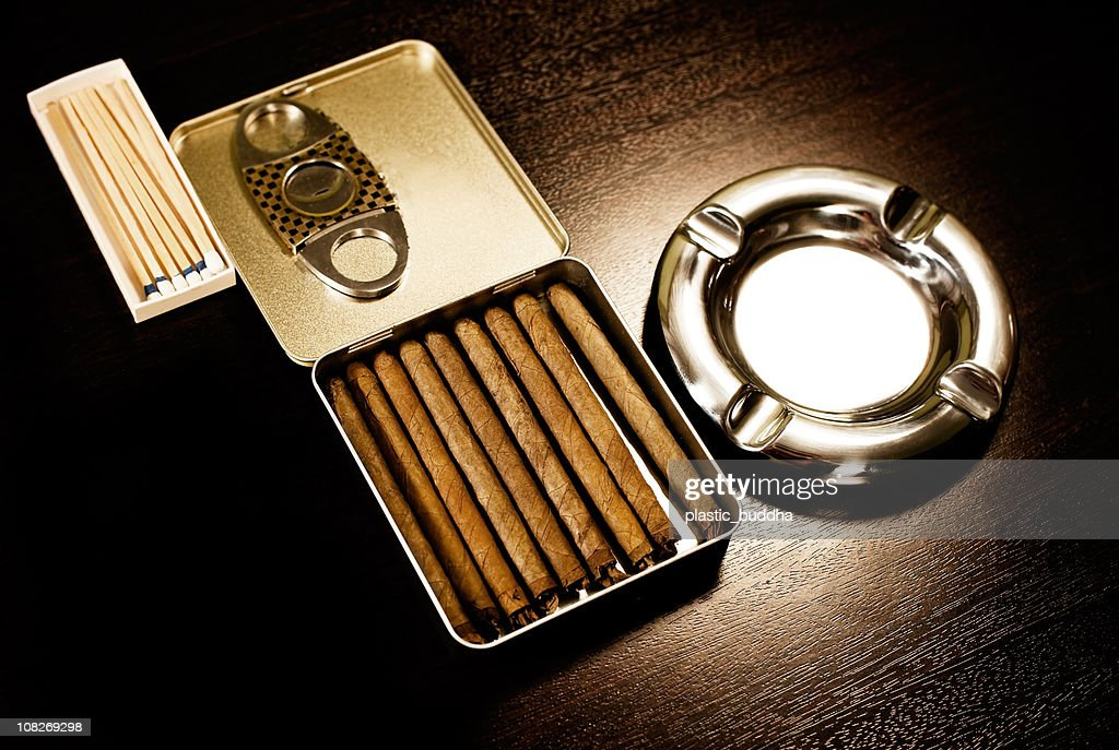 ashtray and cigars on wood table : Stock Photo