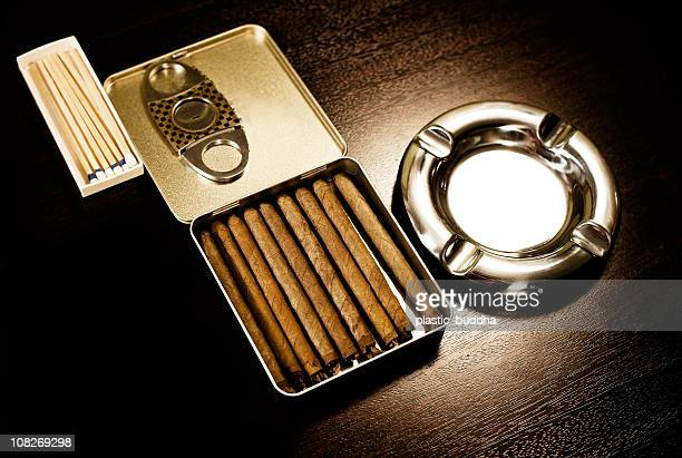 ashtray and cigars on wood table