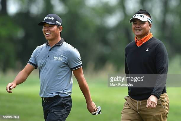 Ashun Wu and Mardan Mamat in conversation during the first round of the Lyoness Open at Diamond Country Club on June 9 2016 in Atzenbrugg Austria