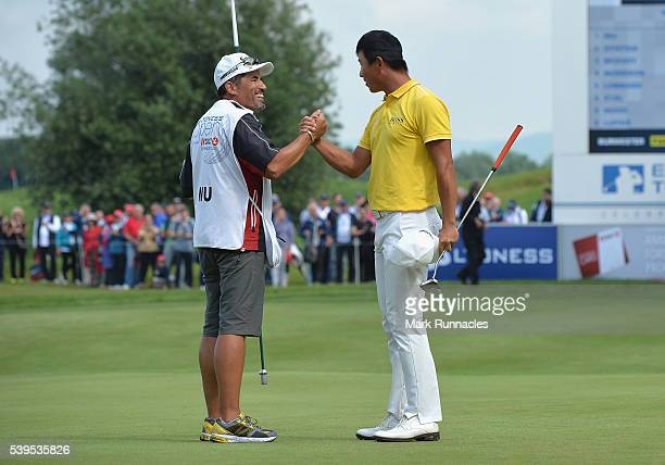 Ashun Wu of China celebrates with his caddy on the 18th green after winning the Lyoness Open during the final round of the Lyoness Open at Diamond...
