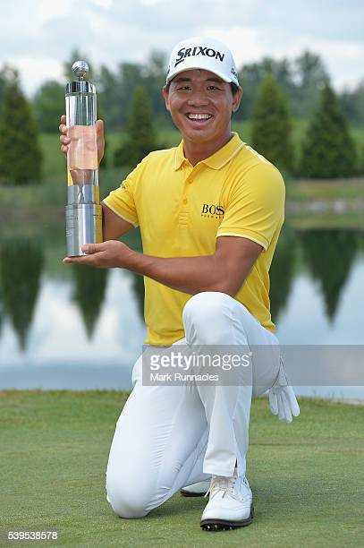 Ashun Wu of China celebrates with the trophy after winning the 2016 Lyoness Open during the final round of the Lyoness Open at Diamond Country Club...