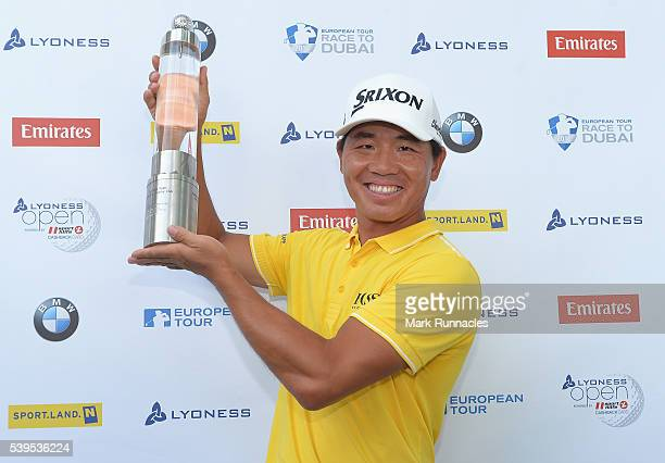 Ashun Wu of China celebrates with the trophy after winning the Lyoness Open during the final round of the Lyoness Open at Diamond Country Club on...