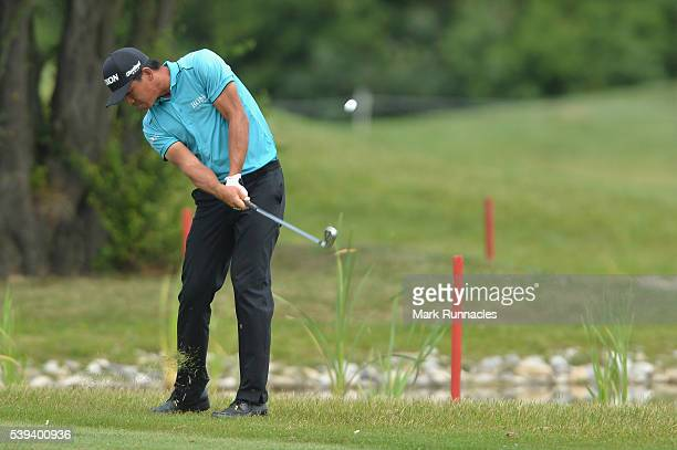 Ashun Wu of China plays his approach shot to the 11th green during the third round of the Lyoness Open at Diamond Country Club on June 11 2016 in...