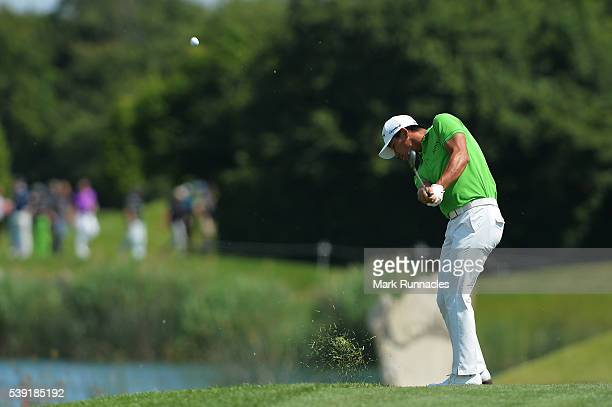 Ashun Wu of China plays his approach shot to the 6th green during the second round of The Lyoness Open at Diamond Country Club on June 10 2016 in...