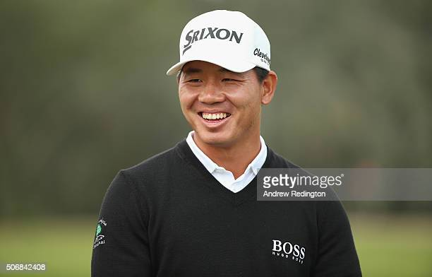 Ashun Wu of China smiles during the ProAm prior to the start of the Commercial Bank Qatar Masters at Doha Golf Club on January 26 2016 in Doha Qatar