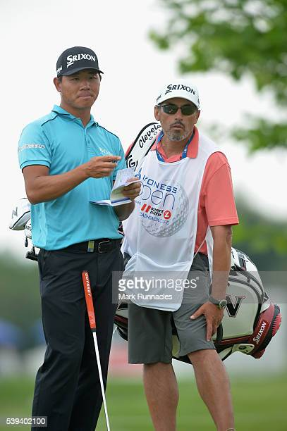 Ashun Wu of China talks to his caddy on the 16th green during the third round of the Lyoness Open at Diamond Country Club on June 11 2016 in...