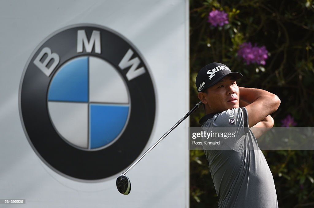 Ashun Wu of China tees off on the 7th hole during day one of the BMW PGA Championship at Wentworth on May 26, 2016 in Virginia Water, England.