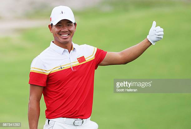 Ashun Wu of China walks to a green during a practice round during Day 3 of the Rio 2016 Olympic Games at Olympic Golf Course on August 8 2016 in Rio...