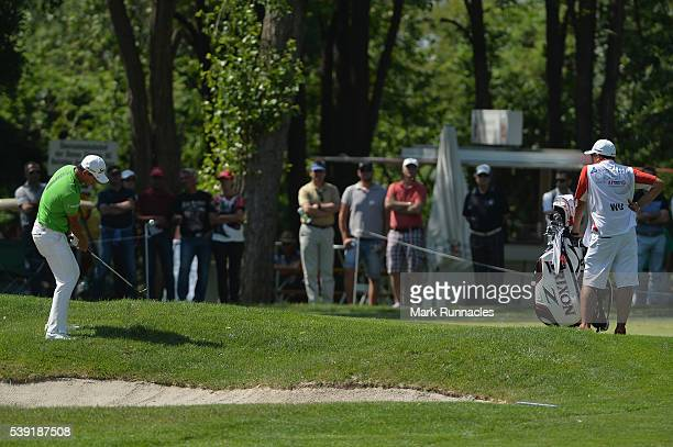 Ashun Wu plays a chip shot during the second round of The Lyoness Open at Diamond Country Club on June 10 2016 in Atzenbrugg Austria