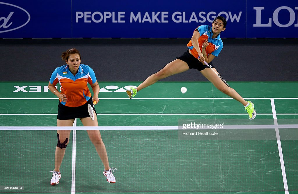 Ashwini Ponnappa and <a gi-track='captionPersonalityLinkClicked' href=/galleries/search?phrase=Jwala+Gutta&family=editorial&specificpeople=795812 ng-click='$event.stopPropagation()'>Jwala Gutta</a> of India in action during their women's doubles match against Shinta Mulia Sari and Lei Yao of Singapore in the Mixed Team Bronze medal at Emirates Arena during day five of the Glasgow 2014 Commonwealth Games on July 28, 2014 in Glasgow, United Kingdom.