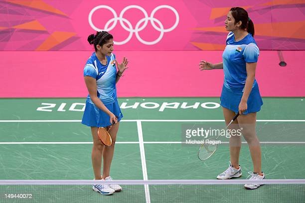Ashwini Ponnappa and Jwala Gutta of India react after a play against Mizuki Fujii and Reika Kakiiwa of Japan during their Women's Doubles Badminton...