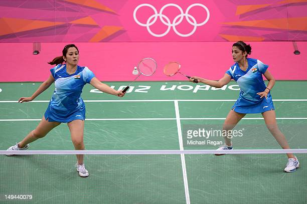 Ashwini Ponnappa and Jwala Gutta of India return a shot against Mizuki Fujii and Reika Kakiiwa of Japan during their Women's Doubles Badminton on Day...