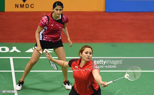 Ashwini Ponnappa of India looks on as Jwala Gutta returns a shot to Ou Dongi and Xiaohan of China during their women's badminton doubles match at the...
