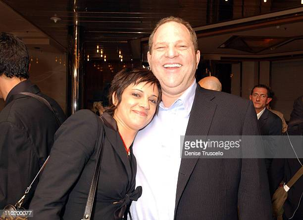 Asia Argento and Harvey Weinstein during 2004 Cannes Film Festival 'The Heart Is Deceitful Among All Things' Premiere at Noga Croisette in Cannes...