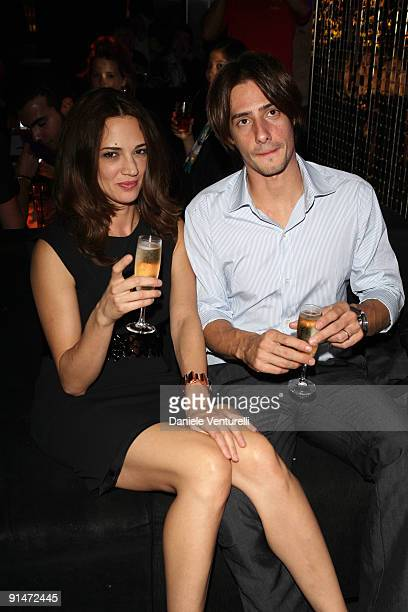 Asia Argento and Michele Civetta attend the John Richmond Party as part of the Paris Womenswear Fashion Week Spring/Summer 2010 at the VIP Room...