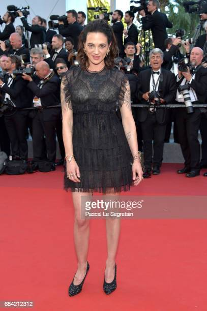 Asia Argento attends the 'Ismael's Ghosts ' screening and Opening Gala during the 70th annual Cannes Film Festival at Palais des Festivals on May 17...