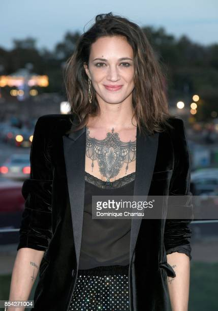 Asia Argento attends the Saint Laurent show as part of the Paris Fashion Week Womenswear Spring/Summer 2018 on September 26 2017 in Paris France