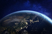 Asia at night from space with city lights showing human activity in China, Japan, South Korea, Taiwan and other countries, 3d rendering of planet Earth, elements from NASA (https://eoimages.gsfc.nasa.