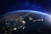 Asia at night from space with city lights showing human activity in China, Japan, South Korea, Hong Kong, Taiwan and other countries, 3d rendering of planet Earth, elements from NASA (https://eoimages