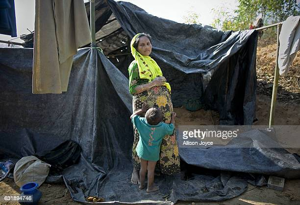 Asia is 8 months pregnant as she stands for a photo with her son in the Balu Kali refugee camp on January 17 2017 in Cox's Bazar Bangladesh She...