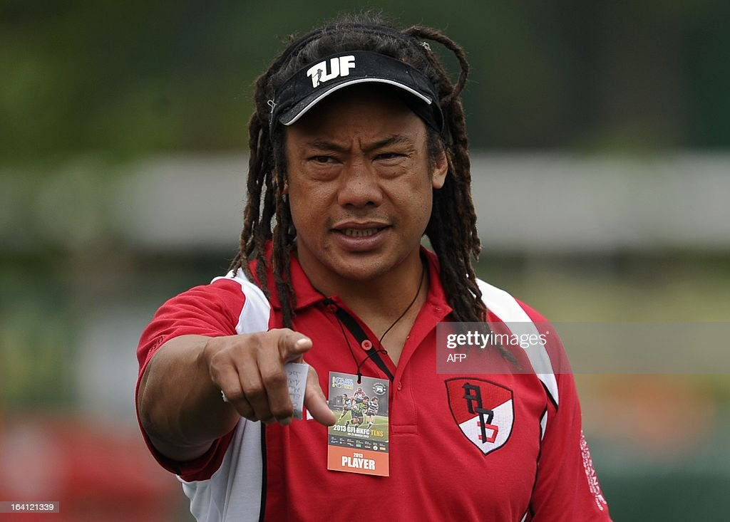 BGC Asia Pacific All Stars head coach and former New Zealand All Blacks captain Tana Umaga speaks to his players player during a training session on the first day of the Hong Kong tens rugby union tournament on March 20, 2013. AFP PHOTO / Dale de la Rey