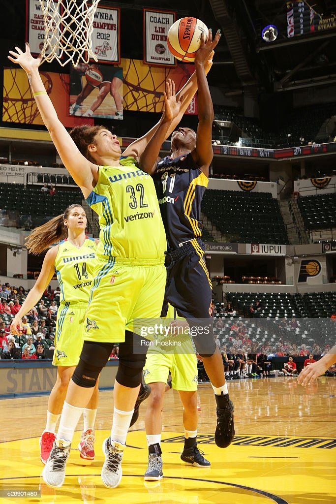 Asia Taylor #31 of Indiana Fever shoots the ball against Amanda Zahui B #32 of Dallas Wings during a preseason game on May 1, 2016 at Bankers Life Fieldhouse in Indianapolis, Indiana.