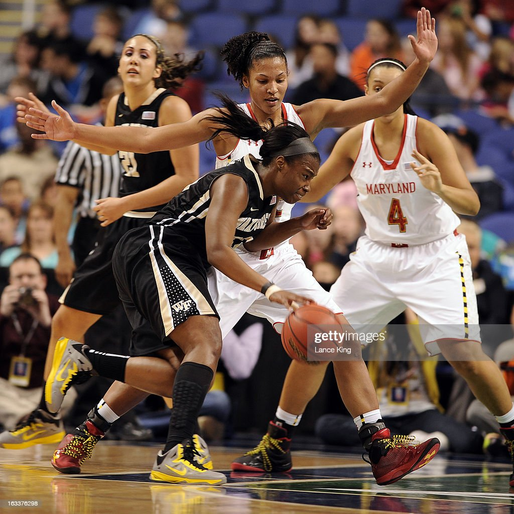 Asia Williams #33 of the Wake Forest Demon Deacons dribbles against Alyssa Thomas #25 of the Maryland Terrapins during the quarterfinals of the 2013 Women's ACC Tournament at the Greensboro Coliseum on March 8, 2013 in Greensboro, North Carolina.