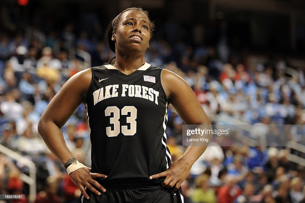 Asia Williams #33 of the Wake Forest Demon Deacons reacts after fouling out against the Maryland Terrapins during the quarterfinals of the 2013 Women's ACC Tournament at the Greensboro Coliseum on March 8, 2013 in Greensboro, North Carolina.