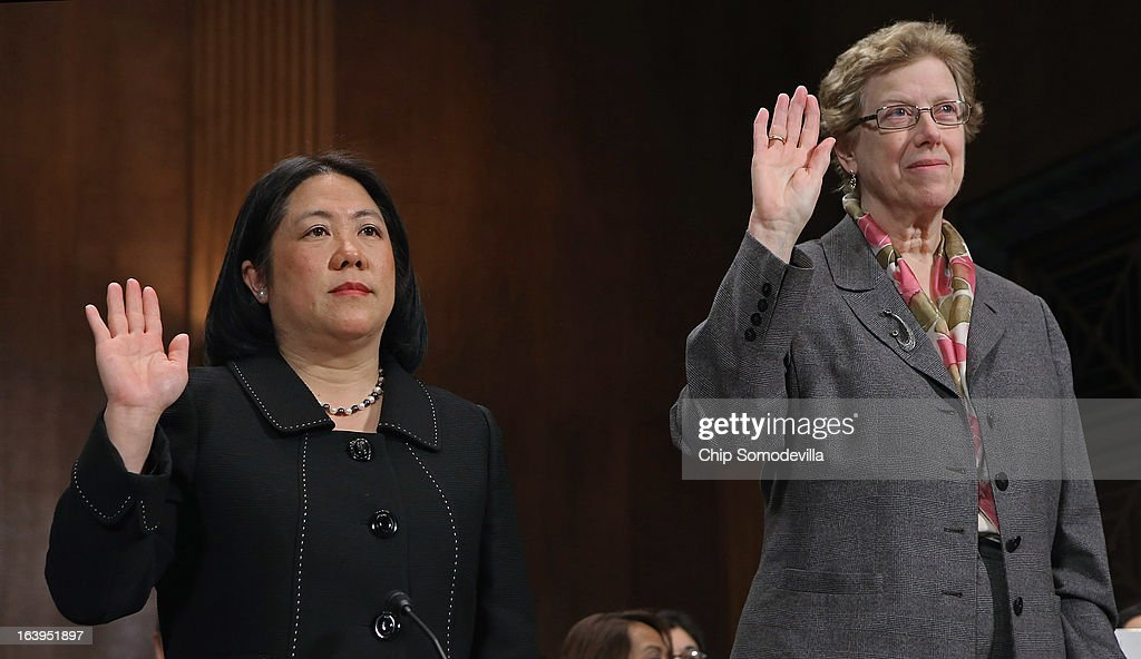Asian American Justice Center President and CEO Mee Moua (L) and Georgetown University International Migration Professor Susan Martin are sworn-in before testifying to the Senate Judiciary Committee March 18, 2013 in Washington, DC. The committee heard testimony about immigration reform in regards to women and families during the hearing, titled 'How Comprehensive Immigration Reform Should Address the Needs of Women and Families.'