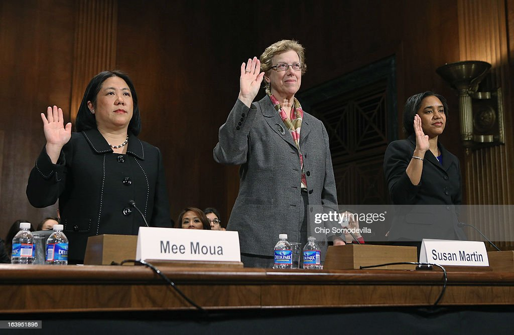 Asian American Justice Center President and CEO Mee Moua, Georgetown University International Migration Professor Susan Martin, National Council of La Raza's Health and Civil Rights Policy Project Director Jennifer Ng'andu are sworn-in before testifying to the Senate Judiciary Committee March 18, 2013 in Washington, DC. The committee heard testimony about immigration reform in regards to women and families during the hearing, titled 'How Comprehensive Immigration Reform Should Address the Needs of Women and Families.'