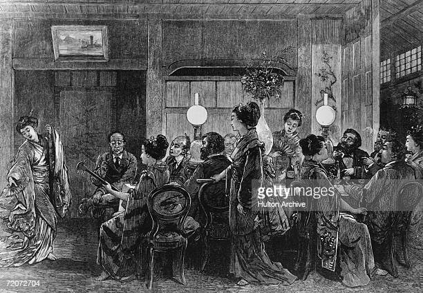 Asian and European Diners are entertained with music and dance at a Japanese dinner party circa 1880