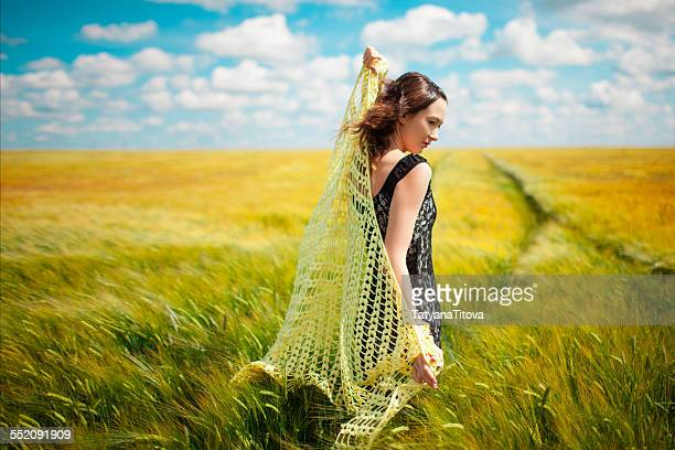 Asian beautiful girl with knitted shawl in wheat f