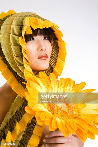 Asian Beautiful Young Woman Fashion Model Wearing Scarf, Holding Sunflower