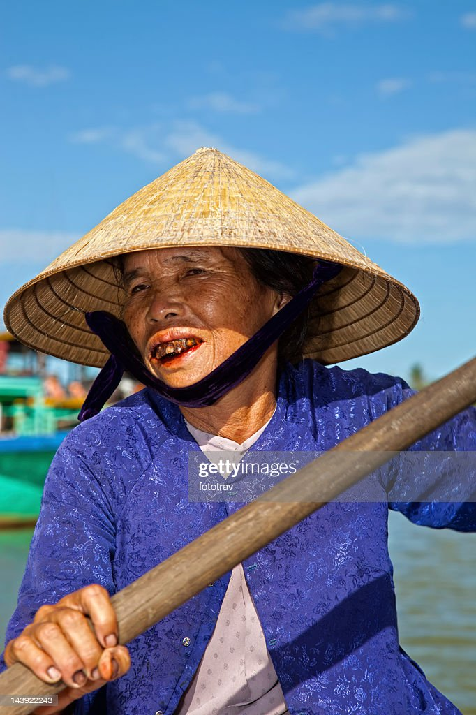 Asian boat driver in Vietnam : Stock Photo