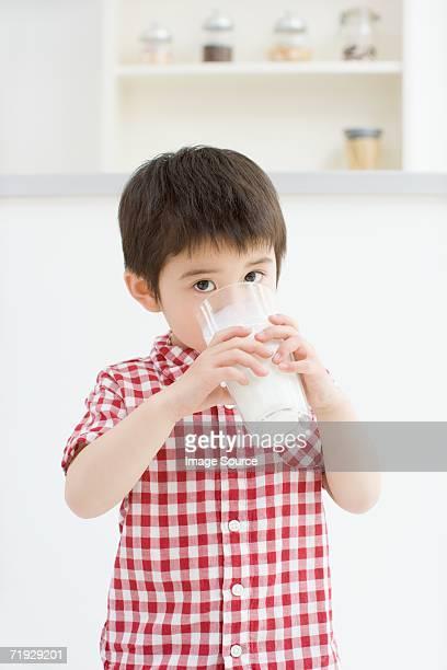 Asian boy drinking milk