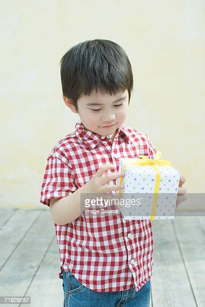 Asian boy holding a gift