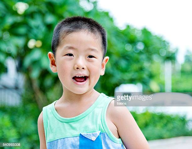Asian boy laughing