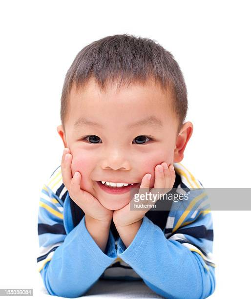 Asian boy with happy smile isolated on white background