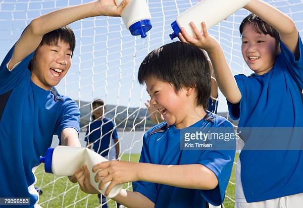 Asian boys playing with water bottles