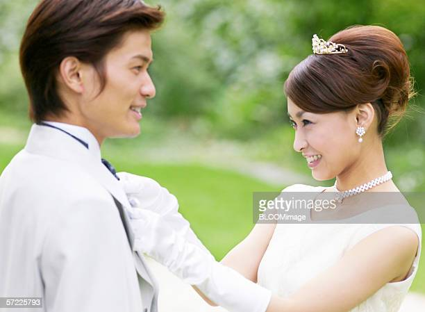 Asian bride and groom smile