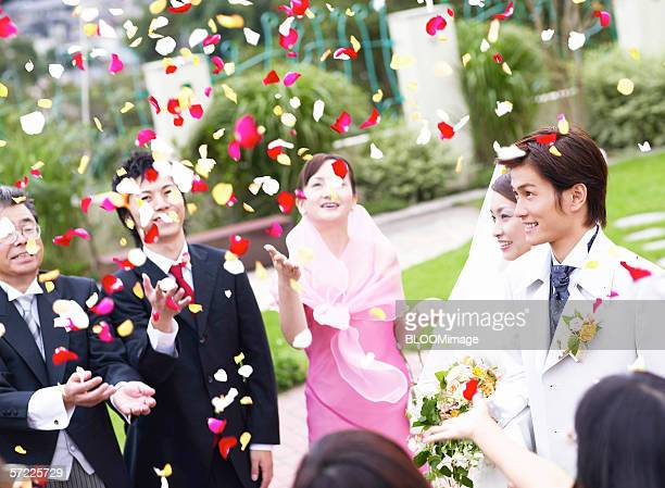 Asian bride and groom smiling in audience
