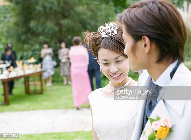 Asian bride and groom smiling