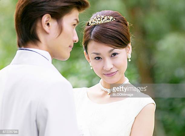 Asian bride smiling with groom